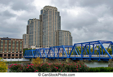 blue bridge in Michigan - Blue bridge with city building in...