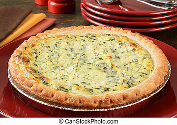 quiche Lorraine - Fresh baked quiche Lorraine on a serving...
