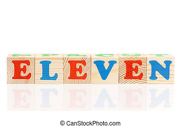 Cubes with letters - Word, number eleven formed by wood...