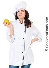 Woman cook in chef hat with green apple, isolated on white...