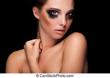 Gorgeous girl with black fashion make up