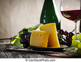 Wine and cheese on rustic wooden table