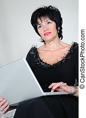 senior woman work on laptop - senior business woman work on...