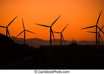 Wind Power Plant at Sunset - Wind Turbine in Utah at Sunset....