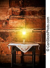 Burning Oil Lamp on the Aged Wooden Table in the Vintage...