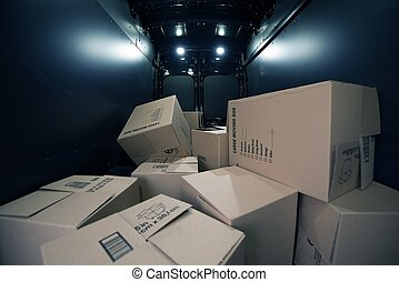 Cardboard Boxes in the Van - Cardboard Moving Boxes in the...