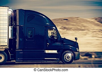Speeding Semi Truck - Speeding Dark Blue Semi Truck in...