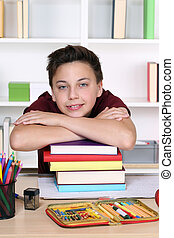 Young student holding his head on a stack of books at school