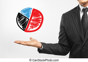 businessman holding pie chart on a white background