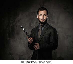 Handsome well-dressed man with walking stick