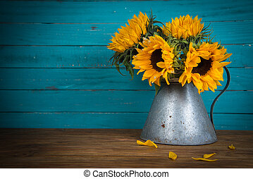 sunflower in metal vase - Fresh sunflower flowers in rustic...