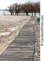 wooden Board walk to the beach in winter