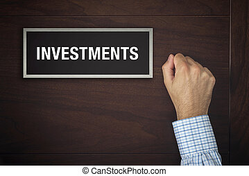 Hand is knocking on Investments door - Male hand is knocking...