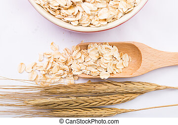 Macro Oat flakes pile on the white background