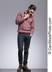 young fashion man looking down - Full body image of an young...