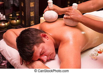 massage - man engaged in Ayurvedic spa treatment