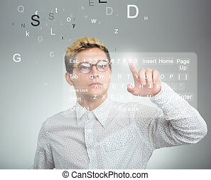 Businessman pressing application button on computer with...