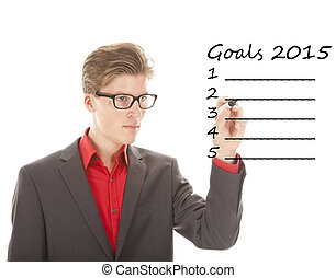Young man writing goals 2015 isolated on white background