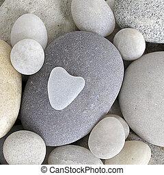 heart shaped pebble - little heart shaped pebble on bigger...