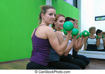 women in a fitness center