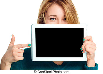 Young cheerful woman is showing blank tablet, isolated over...