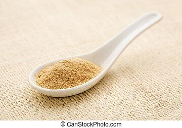 ginseng root powder - organic ginseng root powder on a white...