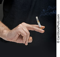 Male hand holding a cigarette - Male hand holding a...