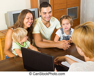 Family with social worker - Positive young parents and two...