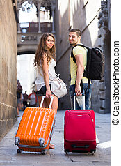 couple traveling with suitcases - Young couple traveling...