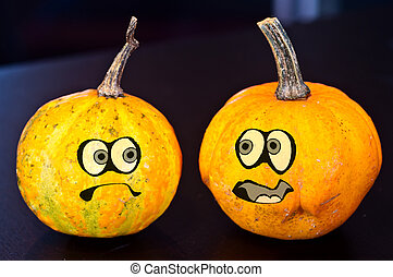 Pumpkins for Halloween with funny friends who play with ghosts -