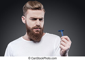 This will not work. Frustrated young bearded man holding...