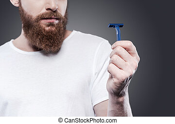 This will not work. Close-up of frustrated young bearded man...