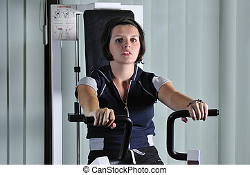 young woman work out in fitness - young healthy woman work...