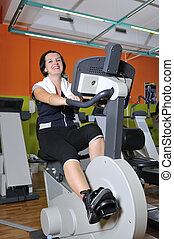 Young woman working out in gym