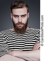 Confidence and masculinity. Confident young bearded man in...
