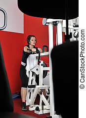 Young woman doing fitness in gym