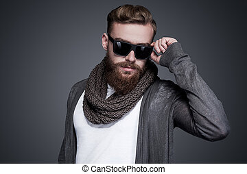 Looking cool and trendy. Handsome young bearded man...