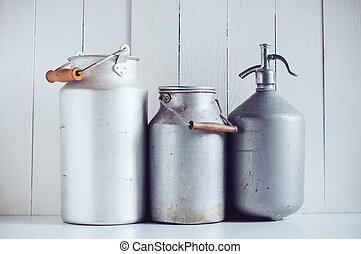 milk cans and a siphon - Two old vintage aluminum milk cans...