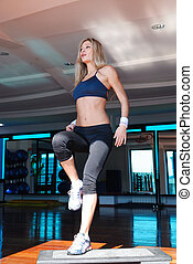 women stepping in a fitness center