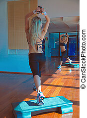 girl exercising in fitness studio