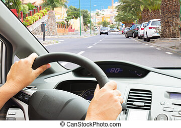 driving a car on street - driving a caron town street, view...