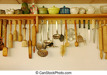 Kitchen ware hanging on the wall. - Kitchen ware hanging on...