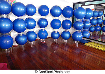 fitness studio with blue pilates balls - fitness club indoor...