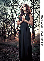 Beautiful goth girl amongst the trees - Portrait of...