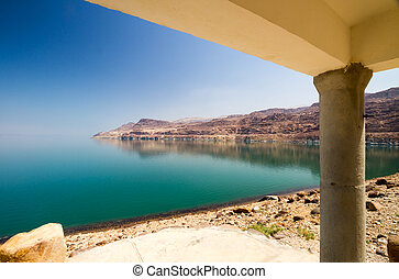 Cottage on the Dead Sea - The green waters of the...