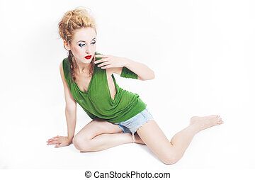 Young beautiful woman sitting on the floor