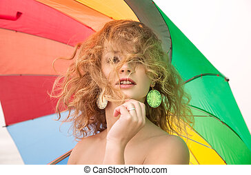 naked girl with a colorful umbrella - Young naked girl with...