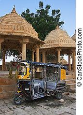 Decorated tuk-tuk parked at Gadi Sagar temple, Jaisalmer,...