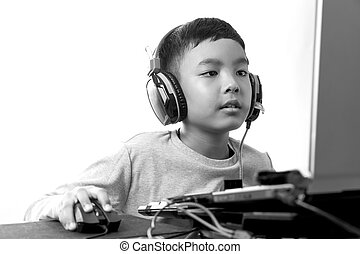 Asian kid play computer games black and white - Asian kid...