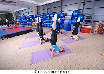 yoga exercise with group of girls